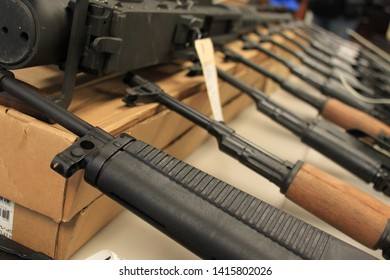 Phoenix, Ariz. / US - January 25, 2011: Guns, handguns, AK-47s and .50 caliber rifles, on display during an announcement about arrests and weapons seizures made during Operation Fast and Furious. 3974
