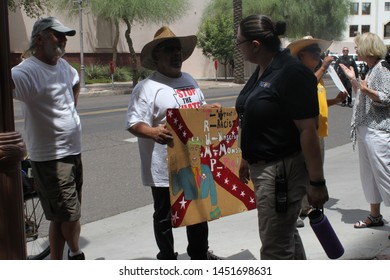 Phoenix, Ariz. / US - July 11, 2015: Supporters and protestors clash at an event where Maricopa County Sheriff Joe Arpaio endorsed presidential candidate Donald Trump. 6067