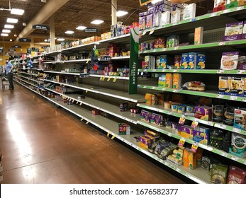 Phoenix, Ariz. / US - March 16, 2020: Hours after a national emergency was official declared for thecoronavirus pandemic,panic shopping leaves shelves almost empty of dried goods. 2086