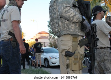 """Phoenix, Ariz. / US - May 29, 2015: Protestors, many carrying weapons, from a """"Muhammad Cartoon Contest"""" event held outside an Islamic Community Center. 5050"""
