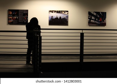 Phoenix, Ariz. / USA - January 31, 2011:  Silhouette of a photographer in the First Amendment Forum at ASU's Walter Cronkite School of Journalism.