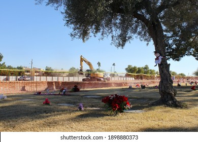 Phoenix, Ariz., USA - January 9, 2020: Heavy machinery and stone vaults are part of an expansion of St Francis Catholic Cemetery as the state is christened a worldwide covid-19 hotspot. 4145