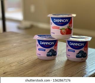 Phoenix, Arizona, April 5th, 2019: Trio of Dannon Yogurt Containers