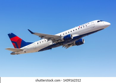 Phoenix, Arizona – April 8, 2019: Delta Connection Embraer ERJ 175 airplane at Phoenix Sky Harbor airport (PHX) in the United States.