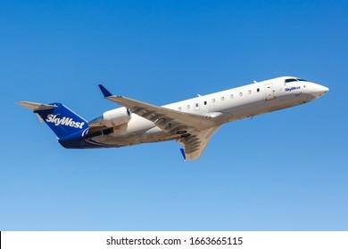 Phoenix, Arizona – April 8, 2019: SkyWest Bombardier CRJ-200 airplane at Phoenix Sky Harbor airport (PHX) in Arizona.
