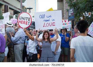 Phoenix, Arizona - August 22, 2017: Anti-Trump protesters demonstrate outside of the Phoenix Convention Center while Trump delivers a speech with unity and love signs