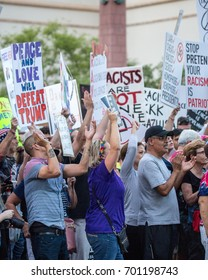 Phoenix, Arizona - August 22, 2017: Anti-Trump protesters demonstrate outside of the Phoenix Convention Center while Trump delivers a speech with anti-hate signs