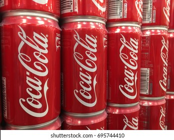 PHOENIX, ARIZONA, AUGUST 6, 2017: Closeup of Stacked Coke Cans