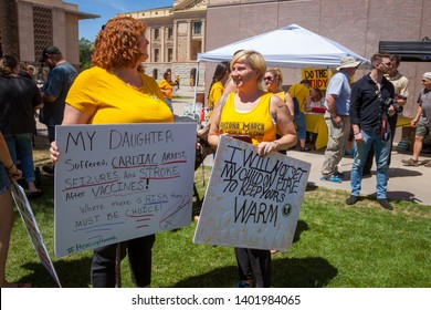 PHOENIX, ARIZONA – MAY 18, 2019: Two mothers holding signs at the Arizona March for Medical Freedom at the State Capitol building. Rally to protect rights to make medical decisions.