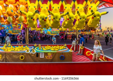 Phoenix, Arizona - October 25, 2017: A Ring a Duck game operator waits for players at the Arizona State Fair in Phoenix.