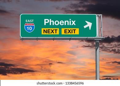 Phoenix Arizona route 10 freeway next exit sign with sunset sky.