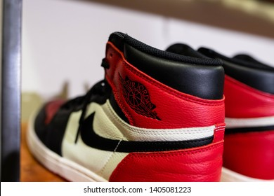 Phoenix, Arizona/ United States- May 20, 2019: A pair of red Nike Air Jordan shoes on top of a shoe rack with other luxurious brands of sneakers. Sneaker heads will love!