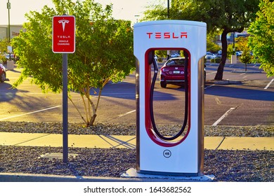 Phoenix, Arizona / USA - January 6, 2020: An available Tesla Supercharger charging station available for use at the Supercharger located in North Phoenix, Arizona on January 6, 2020.