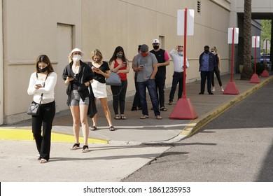 Phoenix, Arizona USA - November 3, 2020: U.S. voters wait in line six-feet-apart and wearing masks, following COVID-19 protocol, outside of the Biltmore Fashion Park polling location in Phoenix, AZ.