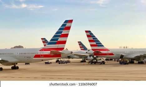 PHOENIX, ARIZONA, USA - OCT 19, 2017: Phoenix International Airport, American Airlines Aircraft taxed after landing at PHX international Terminal. AA plane tails displays red blue logo of the company