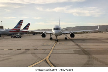PHOENIX, ARIZONA, USA - OCT 19, 2017: Phoenix International Airport, American Airlines Aircraft taxing after landing at PHX Domestic Terminal. AA Airplane follows the marks on the ground that guides