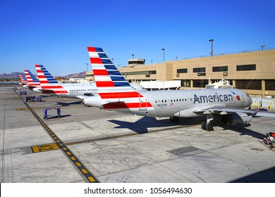 PHOENIX, AZ -24 FEB 2018- View of airplanes from American Airlines (AA) lined up at the gate at the Phoenix Sky Harbor International Airport (PHX) in Arizona.