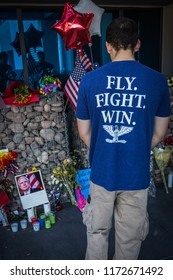 PHOENIX, AZ - AUG. 28, 2018: A visitor stops at the memorial for former Arizona Senator John McCain outside his office. Senator McCain died of brain cancer at the age of 81.