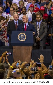 PHOENIX, AZ - AUGUST 22, 2017: U.S. Vice President Mike Pence, flanked by Frankin Graham (L) and Ben Carson (R) speaks to a crowd of supporters for President Trump 2020 rally at Phoenix Convention Center
