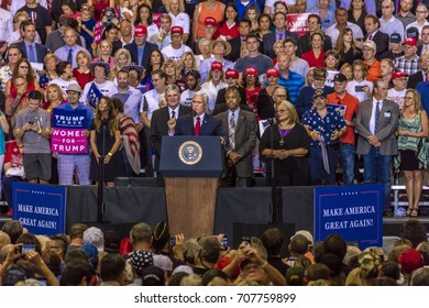 PHOENIX, AZ - AUGUST 22, 2017: U.S. Vice President Mike Pence, flanked by Frankin Graham (L) & Ben Carson (R) speaks to a crowd of supporters for President Trump 2020 rally at the Phoenix Convention Center