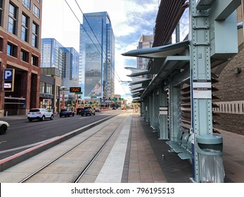 PHOENIX, AZ - DECEMBER 11, 2017: Metro rail train traffic light sign with announcement in Spanish at 3rd St and Washington in Phoenix downtown, Arizona