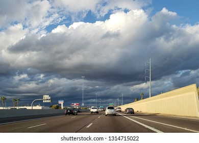 PHOENIX, AZ - FEBRUARY 2, 2019:  Dense storm clouds moving in North Phoenix metro area right above Interstate 17 highway