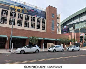 PHOENIX, AZ - JANUARY 31, 2019: Electric cars plugged in curb side quick charging stations in city downtown near Arizona Diamondbacks Chase Arena