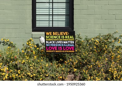 Phoenix, AZ - Mar. 20, 2021 We Believe sign in a front yard says Science is Real, Womens Rights are Human Rights, Black Lives Matter, No Person is Illegal, Love is Love and Diversity Makes us Stronger