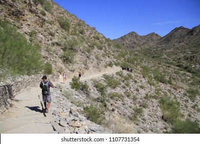 PHOENIX, AZ - MARCH 16: A crew of rescue paramedics and firefighters carry a dehydrated hiker down Piestewa Peak mountain trail on March 16, 2016 in Phoenix, Arizona USA.
