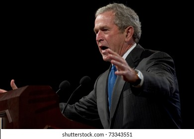 PHOENIX, AZ - MARCH 16: Former President George W. Bush gestures as he speaks at the Phoenix Convention Center on  March 16, 2011 in Phoenix, AZ.