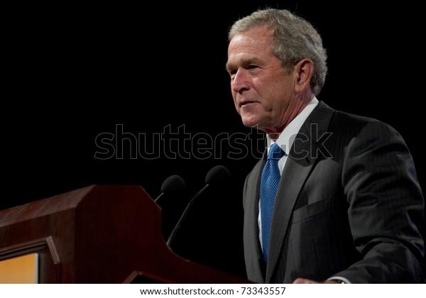 PHOENIX, AZ - MARCH 16: Former President George W. Bush speaks at the Phoenix Convention Center on  March 16, 2011 in Phoenix, AZ.