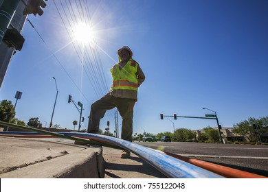 PHOENIX, AZ - OCT 26, 2017: Workers install conduit that will hold fiber-optic communications cables in an infrastructure project for the Paradise Valley School District in Phoenix on Oct. 26, 2017.