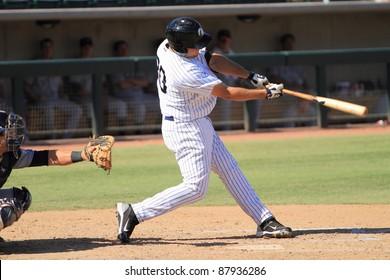 PHOENIX, AZ - OCTOBER 19: Rob Segedin, a High-A New York Yankees prospect, bats for the Phoenix Desert Dogs in an Arizona Fall League game Oct. 19, 2011 at Phoenix Municipal Stadium, Phoenix, AZ.