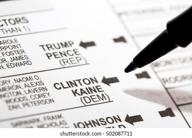 PHOENIX, AZ - OCTOBER 21, 2016: Close up of a pen about to mark the 2016 USA general election early voting ballot form with a vote for Hillary Clinton as president.