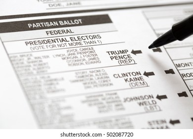 PHOENIX, AZ - OCTOBER 21, 2016: Close up of a pen about to mark the 2016 USA general election early voting ballot form with a vote for Donald Trump as president.
