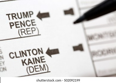 PHOENIX, AZ - OCTOBER 21, 2016: Close up of a pen about to mark the 2016 USA general election voting ballot form with choices of presidential candidates including Donald Trump and Hillary Clinton.