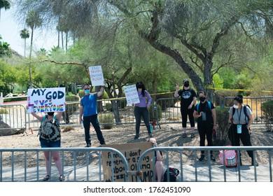 Phoenix AZ, USA. 23rd June, 2020. Protestors at Turning Point event at Dream City Church in Phoenix, Arizona on June 23, 2020.