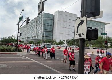 PHOENIX, AZ, USA - APRIL 26, 2018: Arizona teachers dressed up in red shirts marching back from first day of Walk-Out known as RedForEd in Phoenix downtown along Jefferson Road, AZ