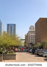 PHOENIX, AZ, USA - DECEMBER 14, 2017: Jefferson Street running East along historic 100 year old high rise buildings and modern skyscrapers in Phoenix downtown, Arizona