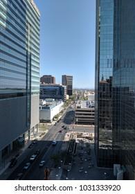 PHOENIX, AZ, USA - FEBRUARY 22, 2018: Birdseye view of central Phoenix crowded downtown streets between modern skyscrapers, Arizona