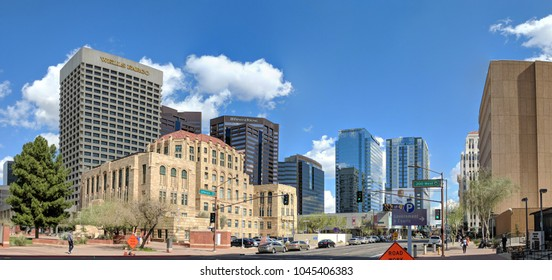 PHOENIX, AZ, USA - FEBRUARY 28, 2018: Jefferson Street going East at at Cesar Chavez Memorial Plaza overshadowed by modern skyscrapers in historic downtown area of major Arizona city of Phoenix.