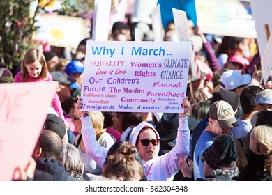 Phoenix, AZ, USA - January 21, 2017: A group of protesters carry signs at the state capitol at the women's march in Phoenix, AZ.