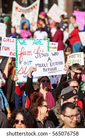 Phoenix, AZ, USA - January 21, 2017: A group of protesters carry signs at the state capitol at the women's march in Phoenix, AZ,  one of hundreds of sister demonstrations in cities around the world.