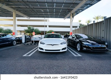 Phoenix, AZ / USA - January 3, 2020: Tesla cars charging at an urban supercharger located at Biltmore Fashion Park mall in Phoenix, AZ. This supercharger has 12 charging stations.