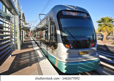 PHOENIX, AZ / USA - JANUARY 8 2011:  A streetcar, of Valley Metro Rail, the light rail line from Mesa and Tempe to Phoenix, westbound to 19th Ave, stopped at a station.