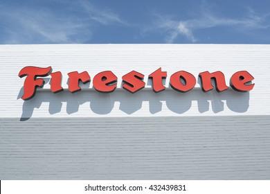 Phoenix, AZ, USA - May 14, 2016: red Firestone sign on white wall in Phoenix, Arizona.