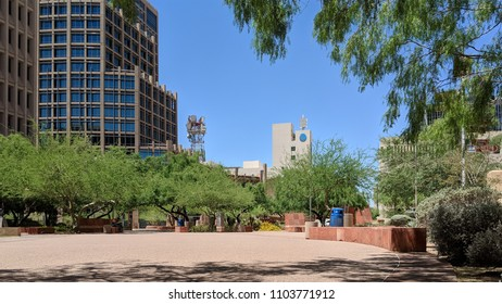 PHOENIX, AZ, USA - MAY 23, 2018:  Cozy small downtown park between new and old Phoenix City Halls provides relaxing and protective shade from scorching mid-day Arizona sun