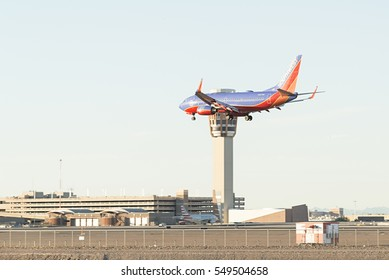 Phoenix, AZ, USA - November 30, 2016: Southwest Airlines airplane is landing at the Phoenix Sky Harbor International Airport. Southwest Airlines Co. is the world's largest low-cost carrier.