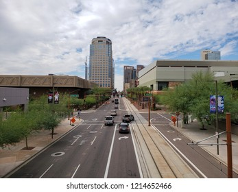 PHOENIX, AZ, USA - OCTOBER 12, 2018:  Washington avenue in West direction near 5th Street in Phoenix downtown with sky covered in dense monsoon clouds, Arizona