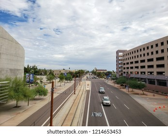 PHOENIX, AZ, USA - OCTOBER 12, 2018:  Washington avenue in East direction near 7th Street in Phoenix downtown with sky covered in dense monsoon clouds, Arizona